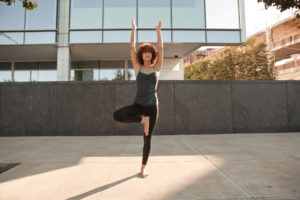woman doing tree pose -- does yoga make you taller