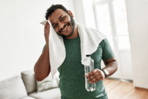 man smiling after workout -- dopamine levels -- what effect does exercise have on heart rate