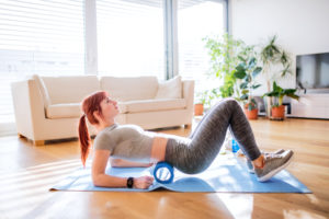 woman foam rolling -- other cool down methods -- hot cold shower